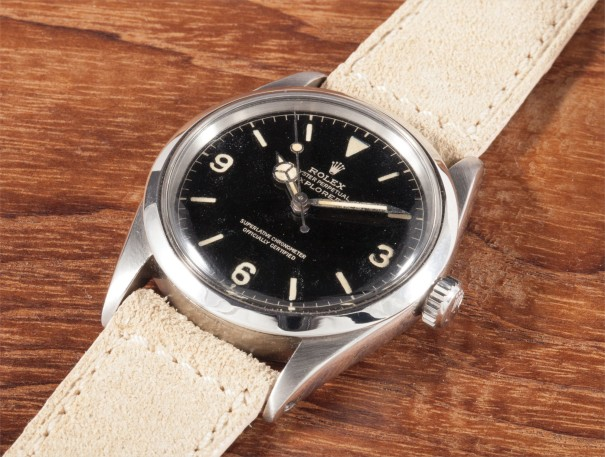 A rare stainless steel wristwatch with black lacquer dial and centre seconds