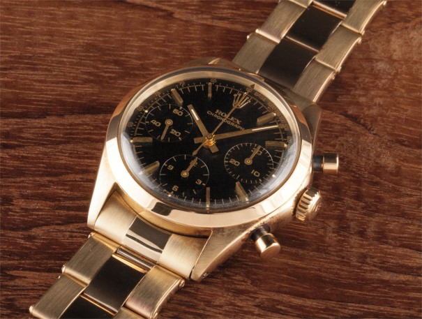 A very rare and attractive yellow gold chronograph wristwatch with black dial and bracelet