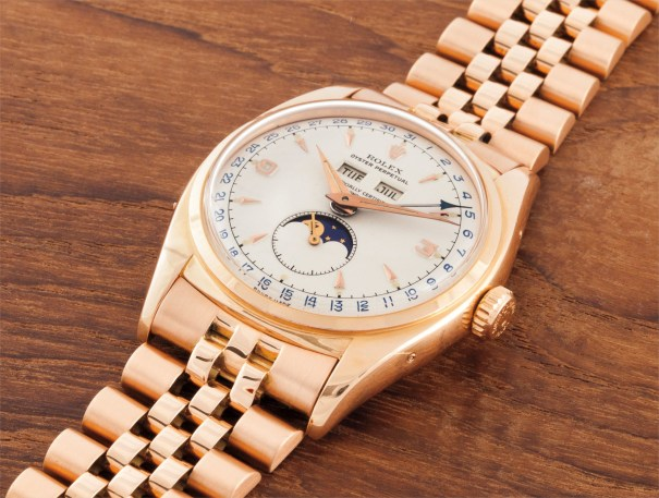 A very rare and very attractive pink gold triple calendar wristwatch with bracelet and moon phases