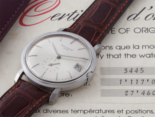An exceptional and rare platinum wristwatch with date and original certificate