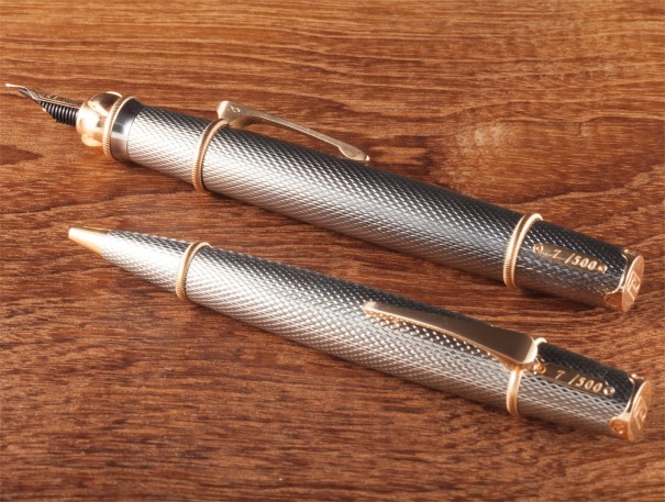 A limited edition set of titanium and pink gold writing instruments, one ballpoint and the other a fountain pen