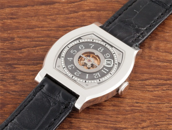 A fine and rare platinum limited edition tonneau wristwatch with wandering hours