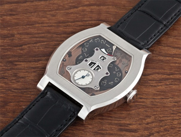 A very rare and unusual platinum limited edition skeletonized tonneau wristwatch with digital form display and power reserve