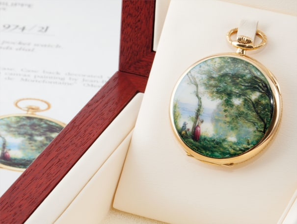 An exceptional and unique openface yellow gold keyless lever watch with enamel miniature painted by Suzanne Rohr, after an 1864 painting by Jean-Baptise Camille Corot