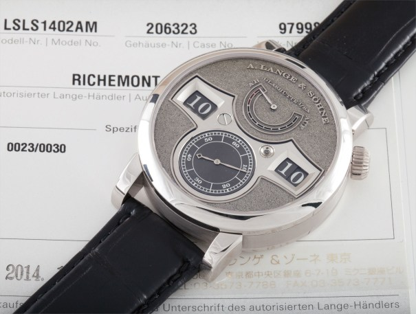 A very rare limited edition wristwatch with digital display, power reserve and unusual white gold hand engraved dial