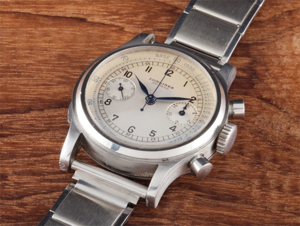 A very fine and rare stainless steel wristwatch with flyback chronograph,  bracelet and unusual case