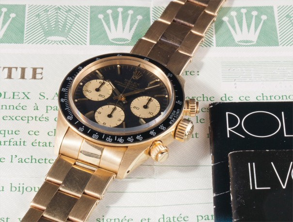 A fine and rare yellow gold chronograph wristwatch with black dial, bracelet, guarantee and box