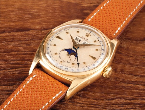 A very rare and attractive yellow gold triple calendar wristwatch with two tone luminous dial