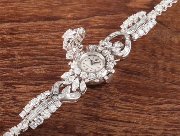 A very rare and attractive platinum and diamond set bracelet watch with concealed dial, retailed by Serpico y Laino