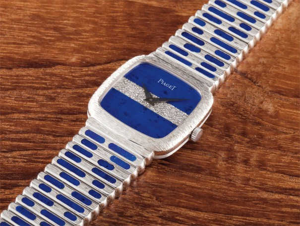 A fine, rare and heavy white gold bracelet watch set with lapis lazuli and diamonds