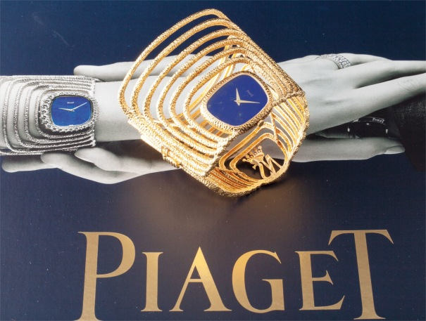 A very fine and rare yellow gold bangle watch with lapis lazuli dial and original fitted box