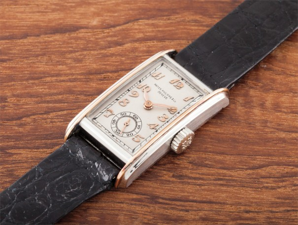 A rare and early rectangular stainless steel and pink gold wristwatch with Breguet numerals