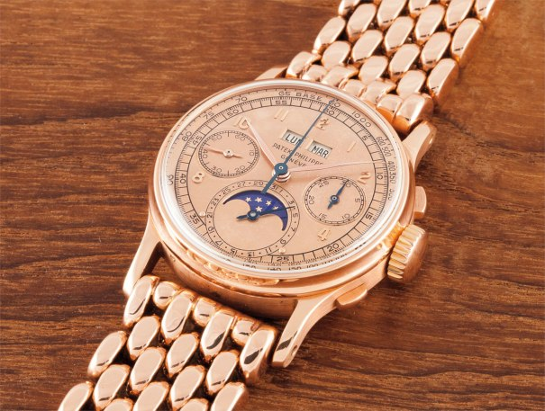 A highly important and very rare pink gold perpetual calendar chronograph wristwatch with pink dial, moon phases and heavy Gay Freres bracelet signed Patek Philippe