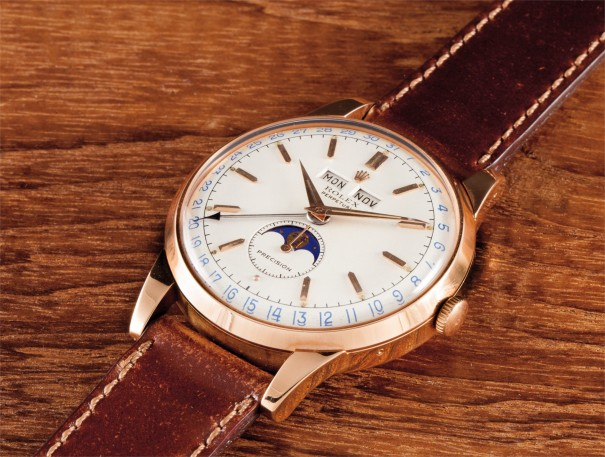 "A very rare, attractive and unusual pink gold triple calendar wristwatch with moon phases and ""Precision"" two-tone luminous dial"