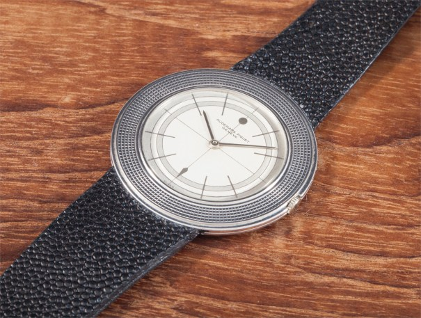 A rare white gold extra flat wristwatch with four-tone dial