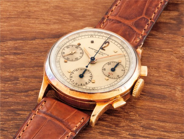 A very fine and rare yellow gold chronograph wristwatch with three registers