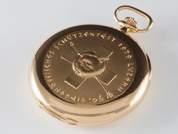 A rare yellow gold hunting cased keyless lever watch, made in commemoration of the 50th Swiss Federal Target Shooting Festival, with original certificate
