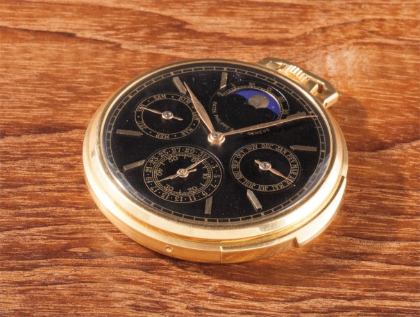 An exceptional and unique yellow gold keyless lever open-face minute repeating perpetual calendar watch with moonphases, black dial and Glucydur balance