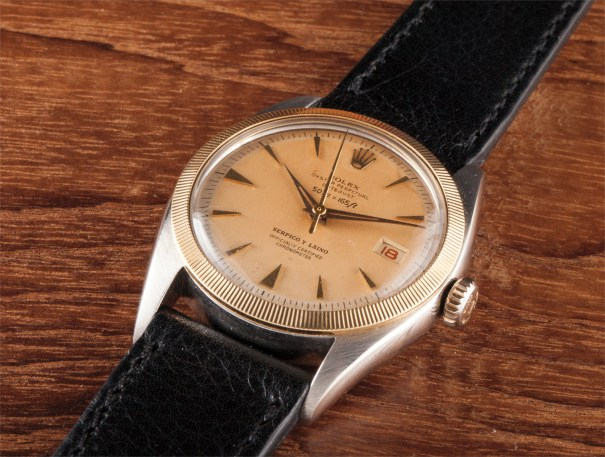A fine and rare stainless steel and yellow gold wristwatch with date, retailed by Serpico y Laino