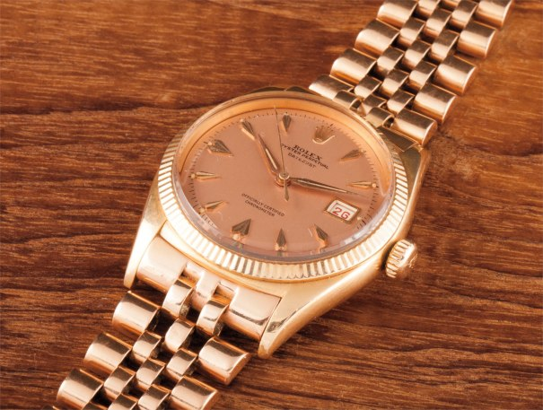 A rare and very attractive pink gold wristwatch with date, pink dial and bracelet