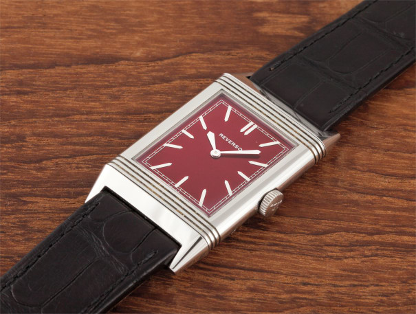 A rare stainless steel special edition reversible wristwatch with red dial