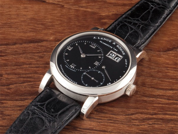 A fine and rare platinum wristwatch with oversized date, power reserve and black dial