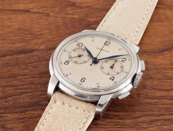 A very fine, rare and large stainless steel wristwatch with flyback chronograph