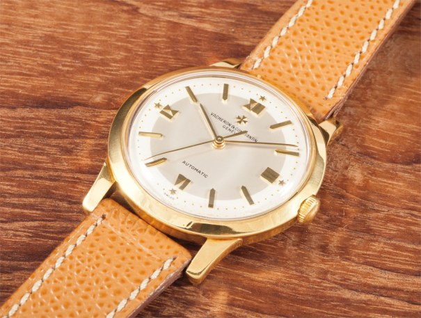 A rare and attractive yellow gold wristwatch with centre seconds and two tone dial
