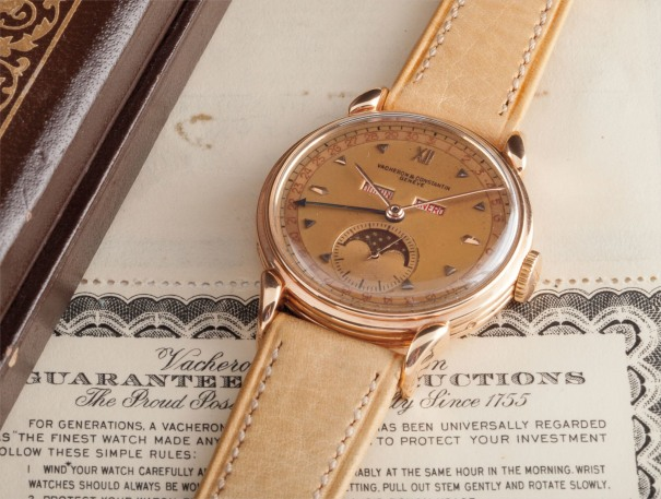 A fine and very rare pink gold triple calendar wristwatch with phases of the moon, original box and certificate