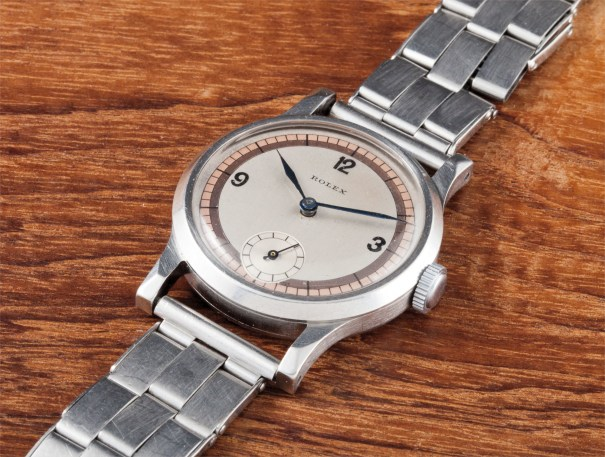 A very rare and attractive stainless steel wristwatch with roulette three-tone dial, unusual angular lugs and Gay Frères bracelet