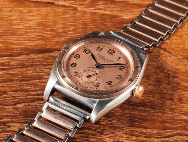 A very rare and attractive stainless steel and pink gold wristwatch with bracelet, two-tone dial and original box, retailed by Mappin & Webb