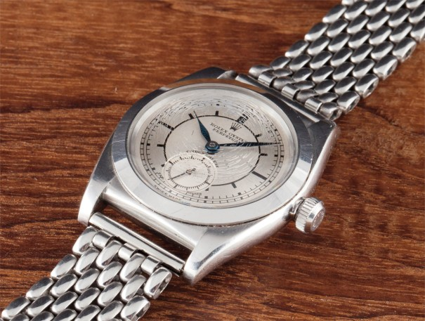 A very rare and attractive stainless steel wristwatch with rice grain bracelet, sector dial and original box