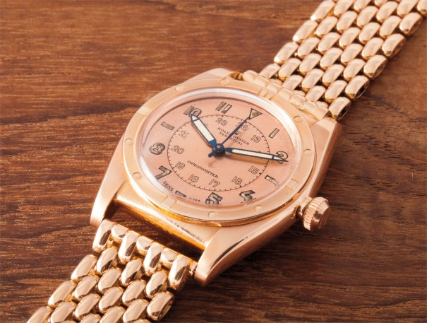 A very fine and rare pink gold wristwatch with centre seconds, 24 hour two tone dial, rice grain bracelet and original box