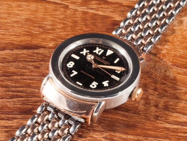 A very rare and attractive stainless steel and pink gold wristwatch with centre seconds, rice grain bracelet, black lacquer California dial, hooded lugs and original box