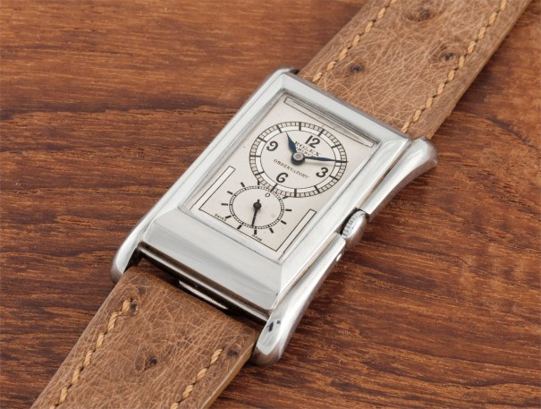 A very rare and very attractive platinum rectangular doctor's wristwatch with flared sides and two-tone dial