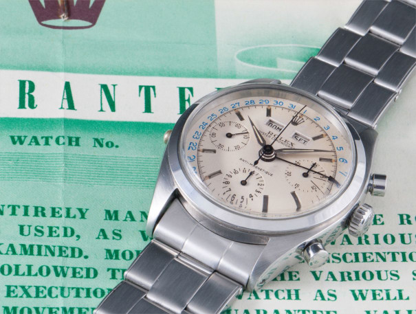 A very fine and rare stainless steel triple calendar chronograph wristwatch with bracelet, two-tone dial and guarantee