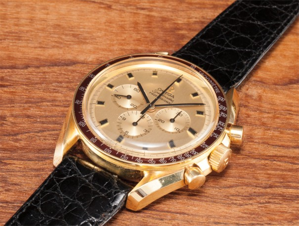A fine and rare yellow gold chronograph wristwatch with original swing tag, gold plated commemorative coin and original box