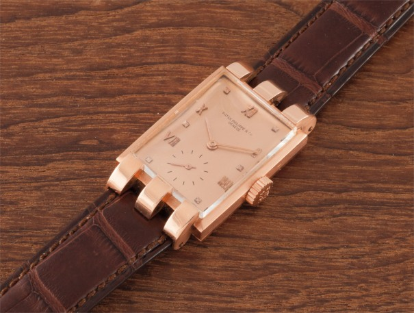A very rare and attractive pink gold wristwatch with pink dial and fancy lugs