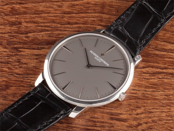 A large platinum wristwatch with slate grey dial