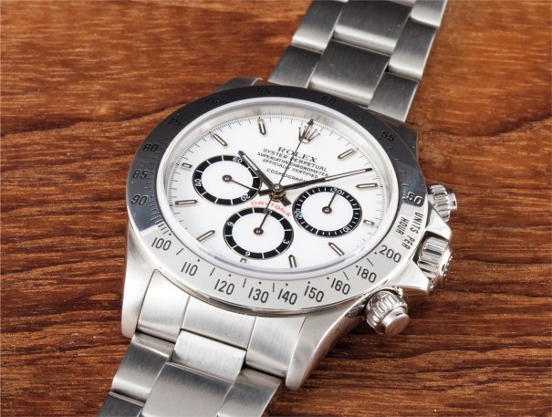 A very rare and attractive stainless steel chronograph wristwatch with enamel dial and 'floating cosmograph' signature