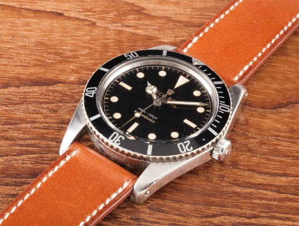 """A rare and attractive stainless steel wristwatch with gilt black lacquer """"exclamation"""" dial"""