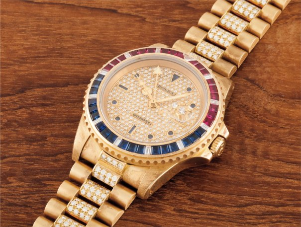 A fine and very rare yellow gold, sapphire, ruby and diamond set calendar wristwatch with bracelet and second time-zone