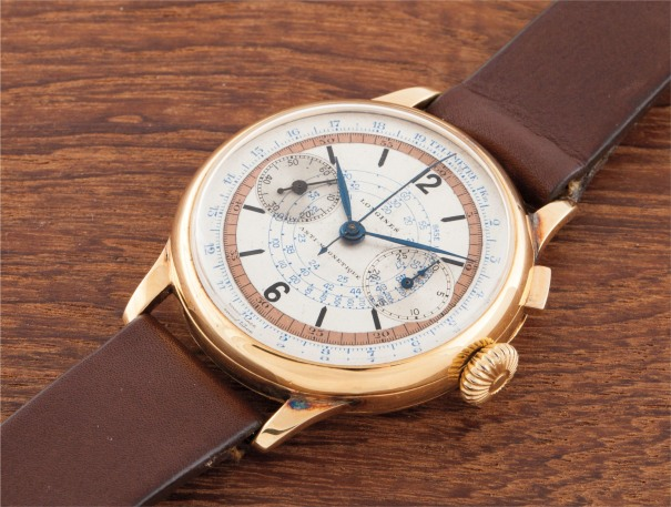 A rare and large yellow gold single button chronograph two-tone dial and hinged case