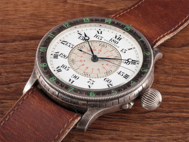 A fine, rare and historically interesting oversized silver aviator's hour angle wristwatch with enamel dial, centre seconds, slide rule, hand written letters, Extract from the Archives and tapestry, formerly the property of Dieudonné Costes