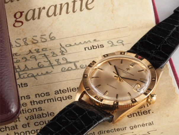 A fine and rare yellow gold wristwatch with date, champagne dial, rotatable bezel, original certificate and box
