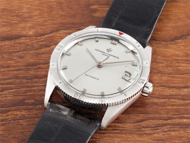 A very fine and extremely rare white gold automatic calendar wristwatch with date, centre seconds and rotatable bezel