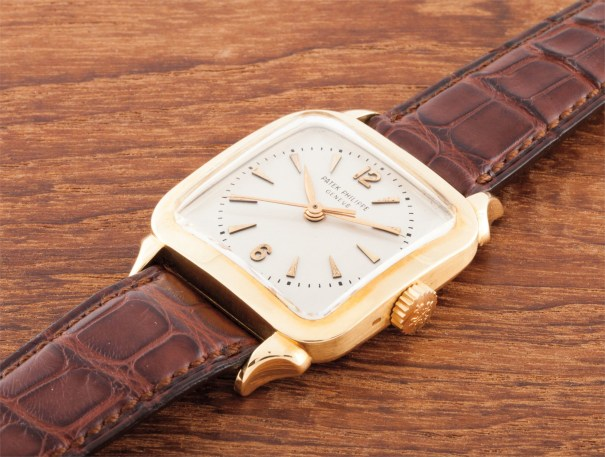 A rare gold square wristwatch with centre seconds