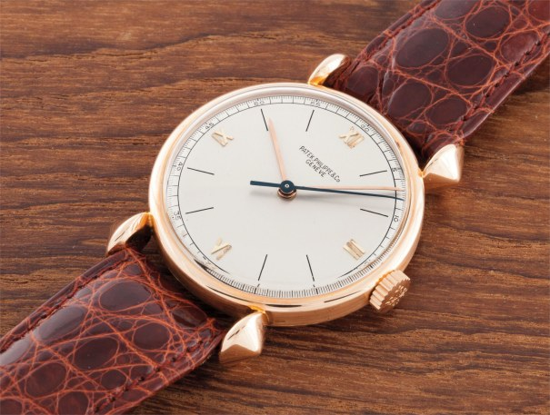 A rare pink gold wristwatch with indirect centre seconds and unusual lugs
