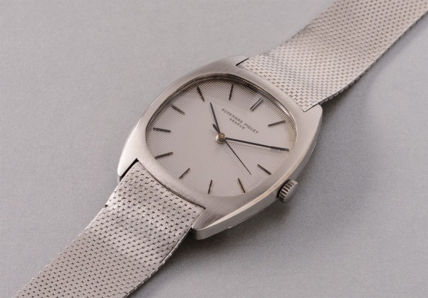 A rare stainless steel tonneau-shaped wristwatch with center seconds and mesh bracelet