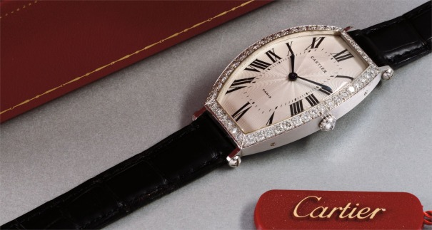 A fine and attractive tonneau-shaped white gold and diamond-set wristwatch